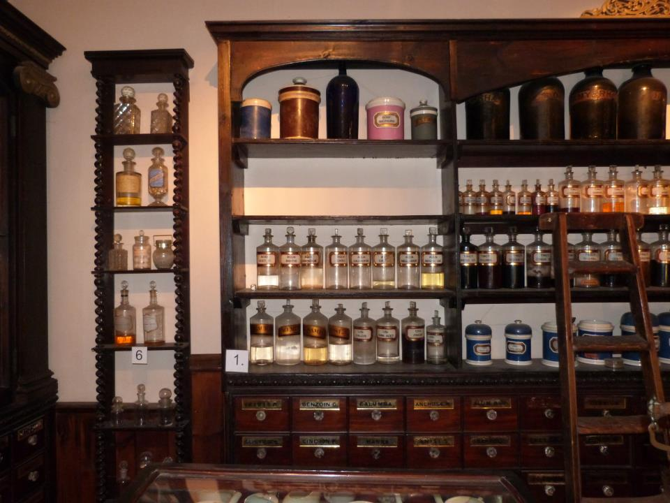 The first shelf emptied of objects in the Victorian pharmacy