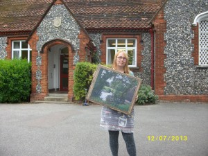 Cas outside Ickleford School with the copy of the Ratcliffe painting we have given them (it's a photo on canvas, and came out really well)