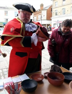 The Town Crier looking at our Samian ware